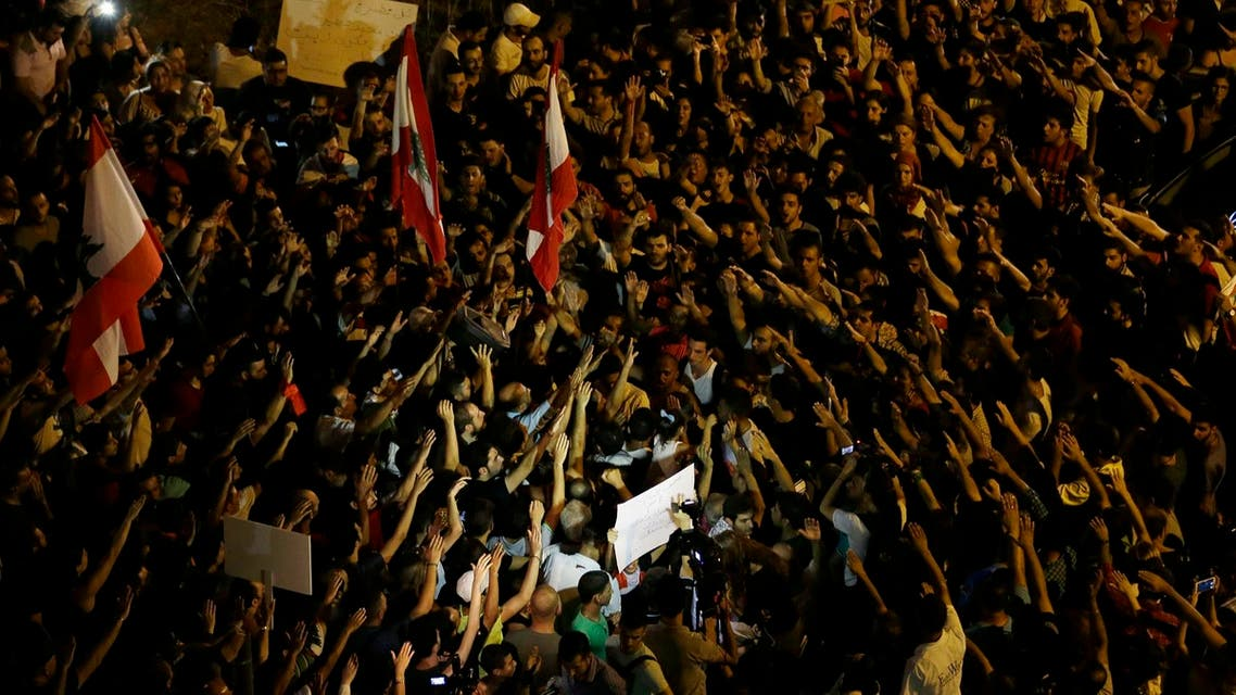 Lebanese activists chant slogans during an anti-government protest in front the main Lebanese government building, downtown Beirut, Lebanon. (AP)