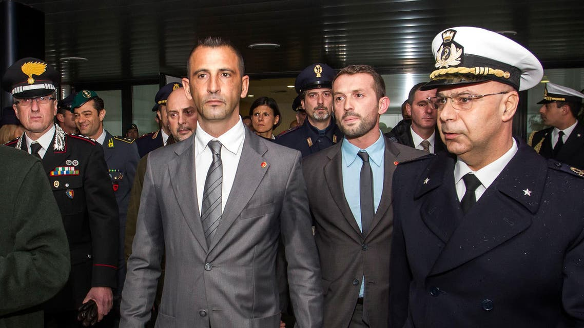 Italian marines Massimiliano Latorre, center left, followed by Salvatore Girone, second from right, upon their arrival from India at Rome's Leonardo da Vinci airport. (File: AP)