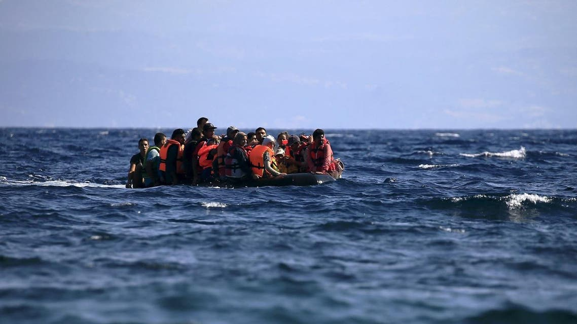 Syrian refugees on a dinghy approach, in rough seas, a beach on the island of Lesbos, Greece August 23, 2015. (Reuters)