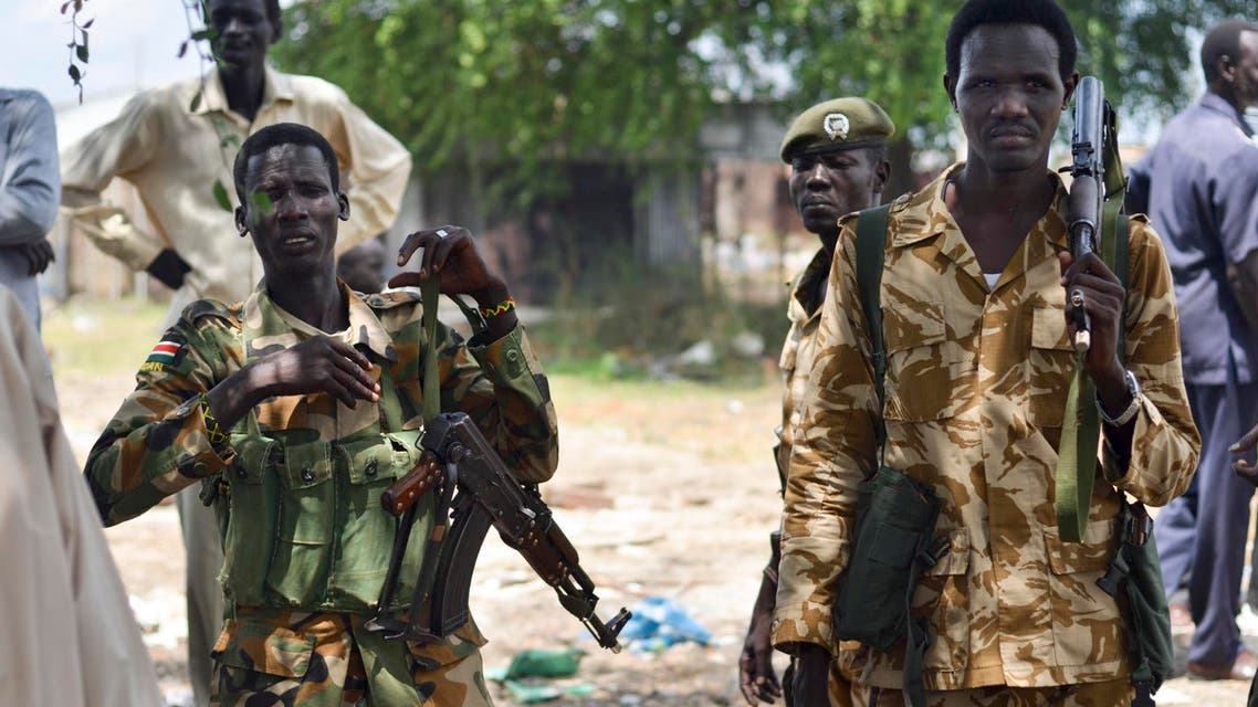 In this photo taken Wednesday, June 24, 2015, South Sudanese government soldiers patrol in Bentiu town, South Sudan.  AP