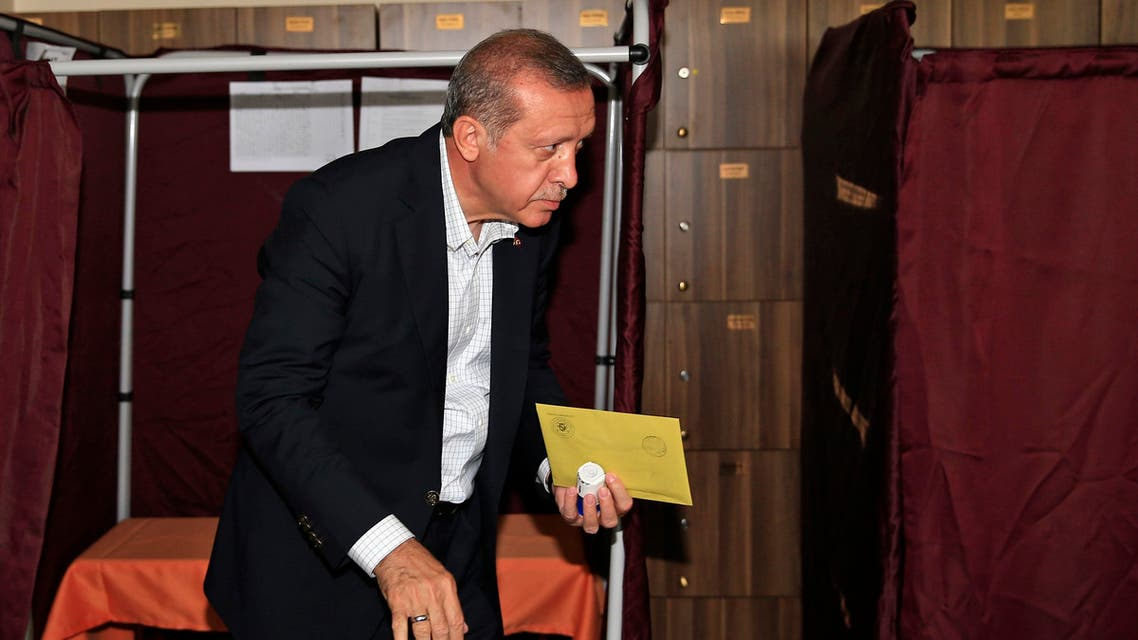 Turkey's President Recep Tayyip Erdogan walks to cast his vote at a polling station in Istanbul, Turkey, Sunday, June 7, 2015. (AP)