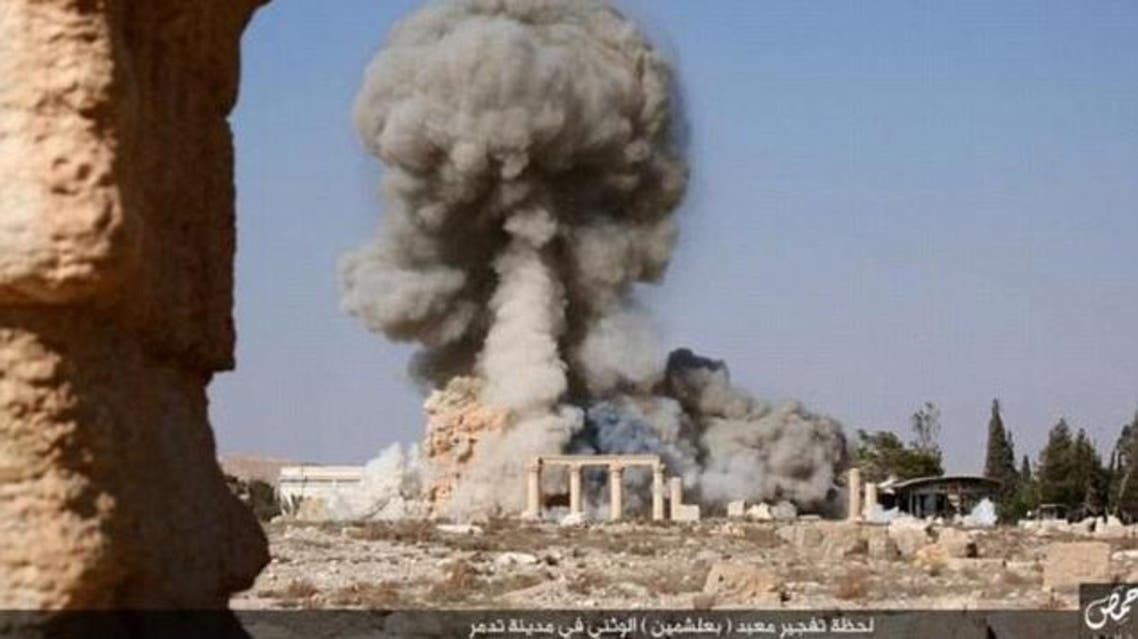 Smoke rises from the Baalshamin temple after ISIS militants filled it with explosives and detonated them in the ancient wonder. (Twitter)