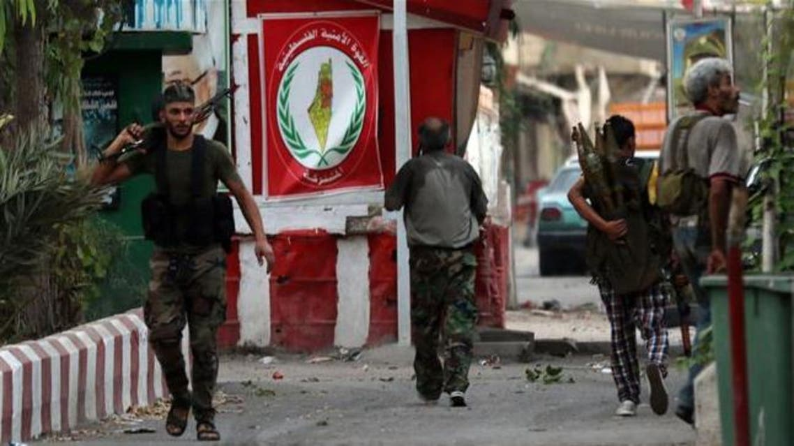 Armed men walk in the streets of Ain al-Hilweh Palestinian refugee camp near Lebanon's southern port city of Sidon following clashes on August 22, 2015. (AFP)