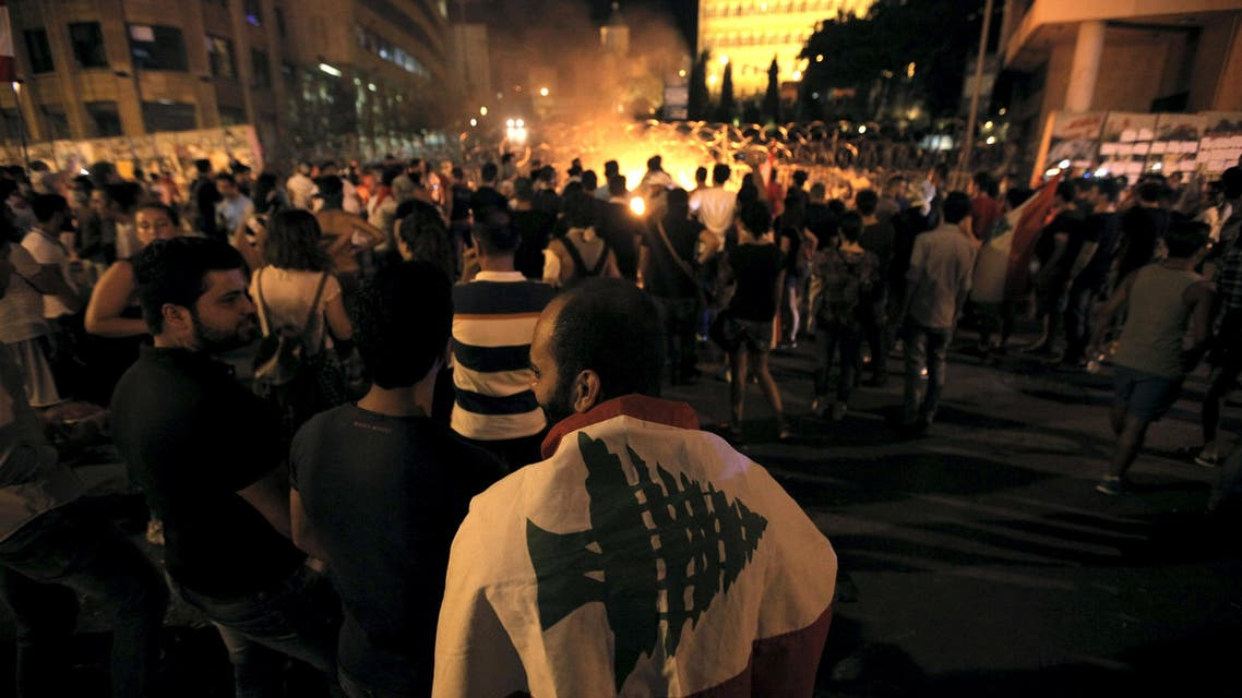 Protesters gather near a fire during a protest against corruption and against the government's failure to resolve a crisis over rubbish disposal, in front of the government palace in Beirut. (Reuters)