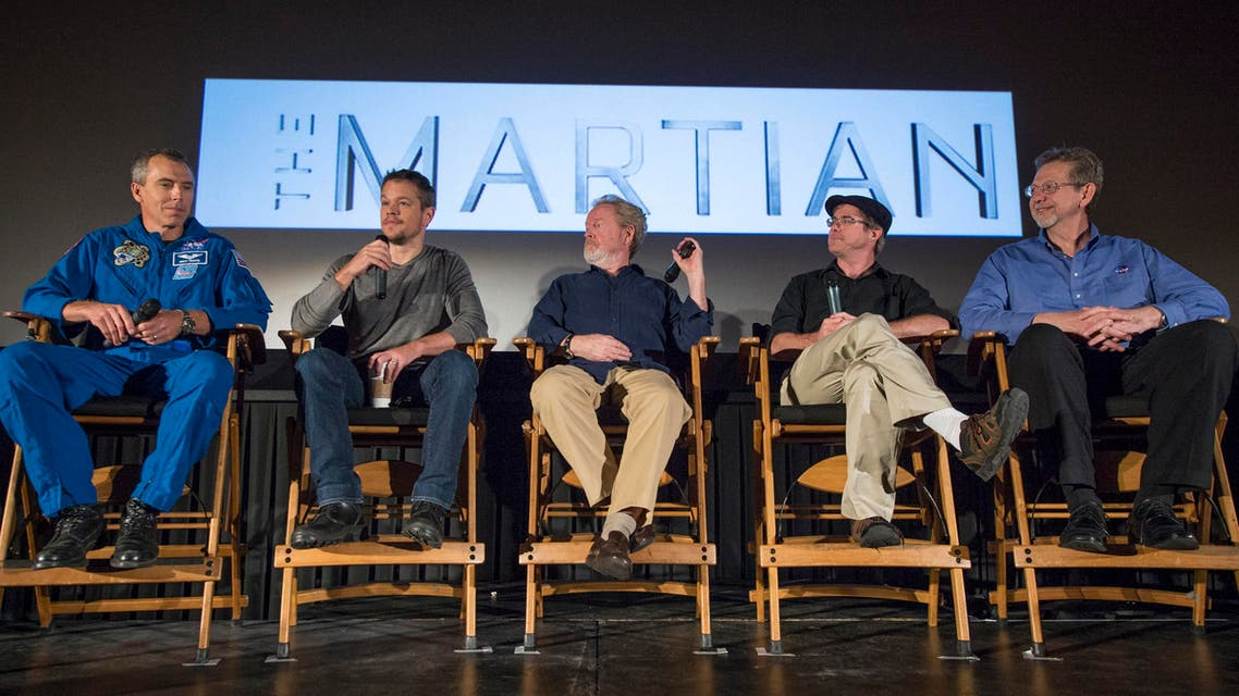 """In this image released by NASA, Astronaut Drew Feustel, from left, actor Matt Damon, director Ridley Scott, author Andy Weir, and Director of the Planetary Science Division at NASA Headquarters Jim Green, participate in a question and answer session about NASA's journey to Mars and the film """"The Martian,"""" on Tuesday, Aug. 18, 2015, at the United Artists Theater in La Canada Flintridge, Calif. The movie, based on the book by Andy Weir, gives a realistic view of the climate and topography of Mars. NASA scientists and engineers served as technical consultants on the film. (Bill Ingalls/NASA via AP)"""