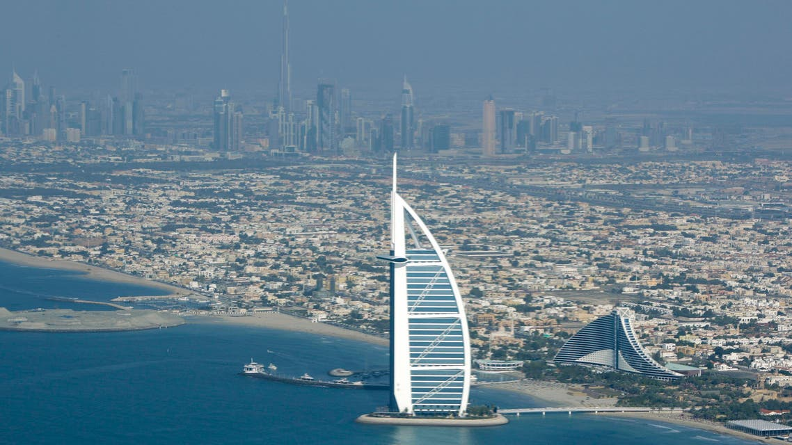 Burj Al Arab, the luxury hotel foreground, and Burj Dubai, the world's tallest building, in background centre are seen from the plane in Dubai, United Arab Emirates, Sunday, Jan. 3, 2010. (AP)