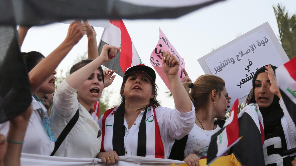 Protesters chant in support of Iraqi Prime Minister Haider al-Abadi as they carry national flags during a demonstration in Tahrir Square in Baghdad, Iraq, Friday, Aug. 21, 2015.  AP