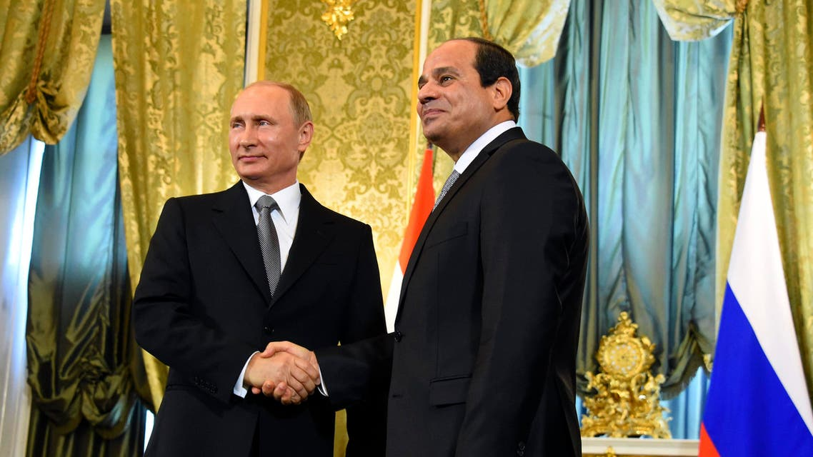 In this photo provided by Egypt's state news agency MENA, Russian President Vladimir Putin, left, greets Egyptian President Abdel-Fattah el-Sisi in Moscow, Russia, Wednesday, Aug. 26, 2015. AP