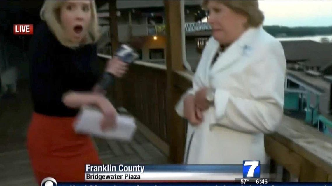 his TV video frame grab courtesy of WDBJ7-TV in Roanoke, Virginia shows Alison Parker (L) the moment shots ring out during an interview on tourism with Vicki Gardner. (AFP)