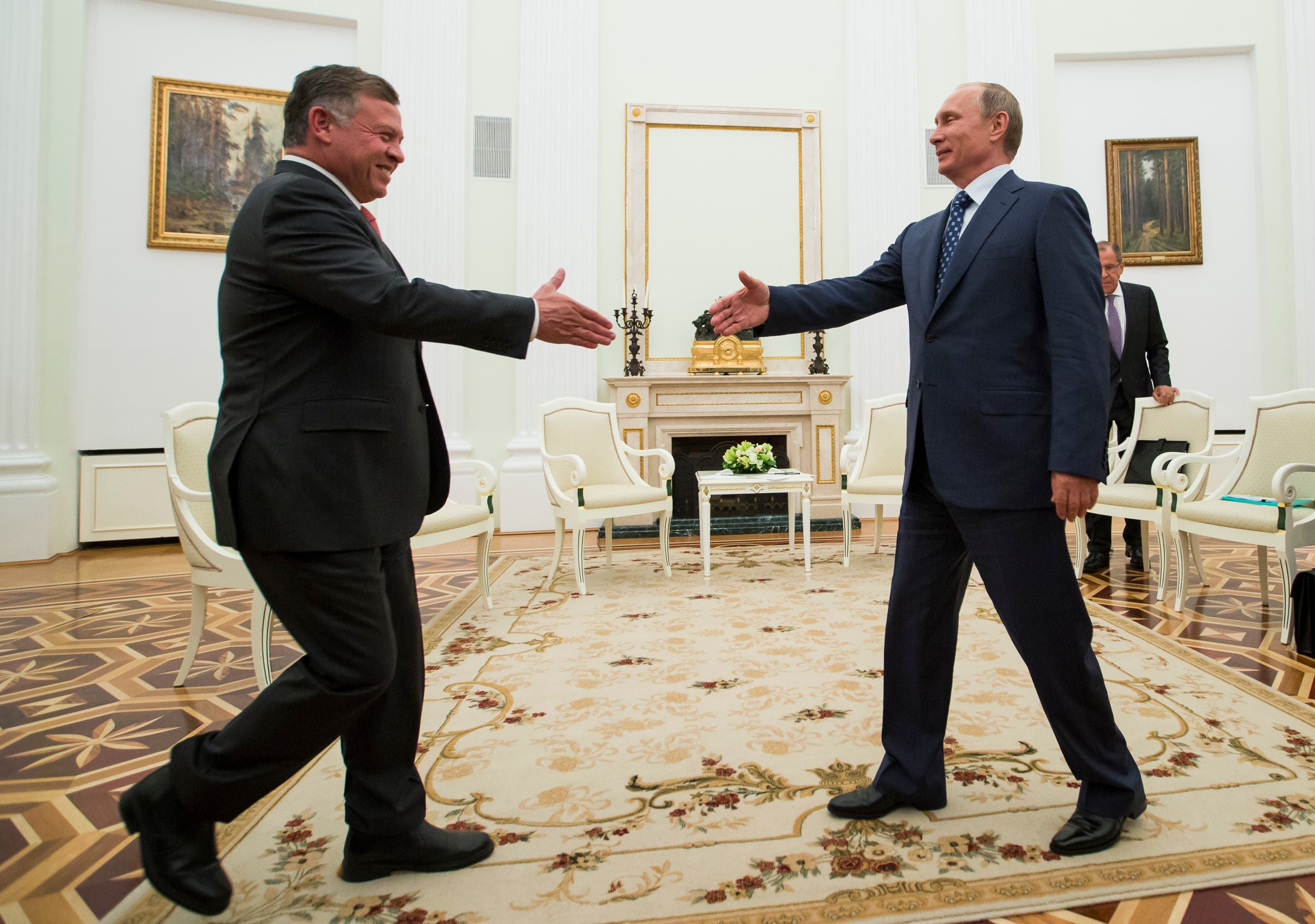 Russian President Vladimir Putin, right, shakes hands with King Abdullah II of Jordan during their meeting in the Kremlin, in Moscow, Russia,  Aug. 25, 2015.  (AP)