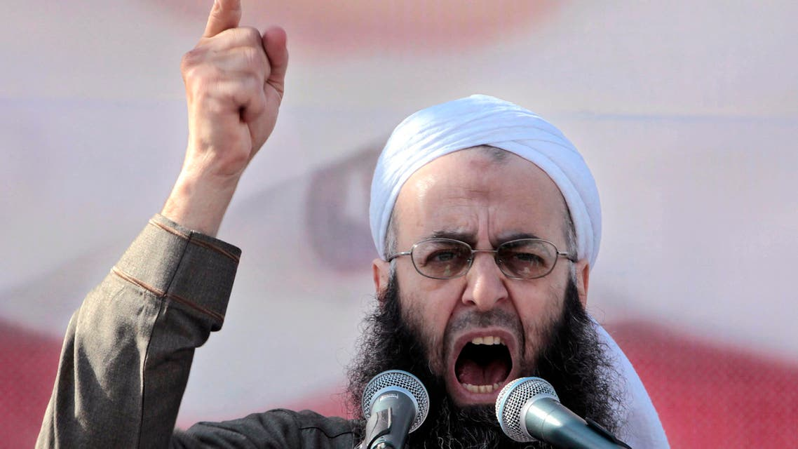 In this March 4, 2011, file photo, Sheikh Ahmad al-Assir, a Lebanese anti-Syrian regime leader, addresses his supporters during a demonstration against Syrian President Bashar Assad at the Martyrs square in downtown of Beirut, Lebanon. (AP)