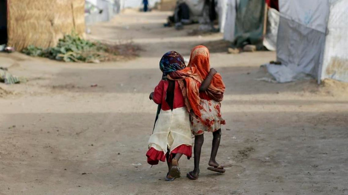 mi and Ashbu, both three-years-old, walk arm in arm in the Zafaye refugee camp, some 15 kms (10 miles) from downtown N'djamena, Chad. (File photo: AP)