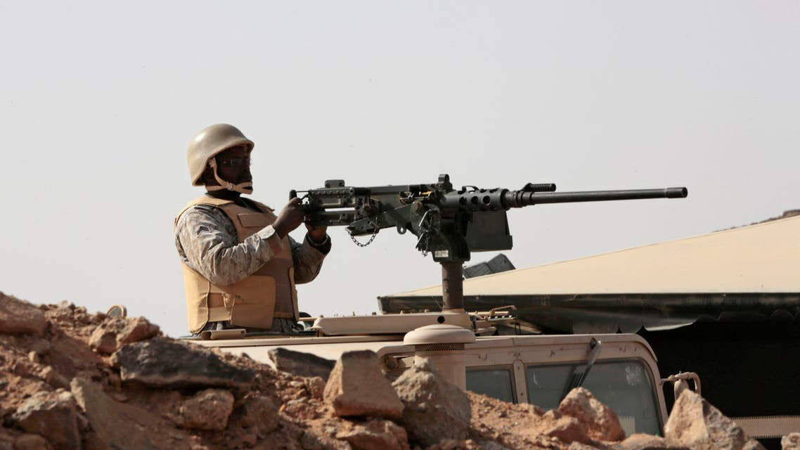 A Saudi soldier sits on top of an armor vehicle as he aims his weapons, on the border with Yemen, at a military point in Najran, Saudi Arabia. Reuters