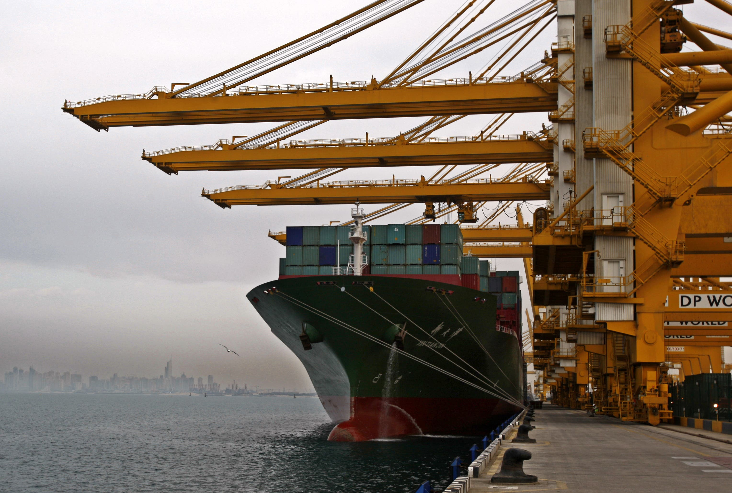 In this Sunday, Feb. 8, 2009 file photo, a cargo ship docks to off load its containers at the Jebel Ali port terminal 2 in Dubai, United Arab Emirates. (File photo: AP)