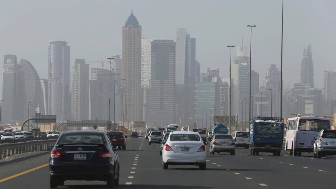 Cars pass by the Business Bay Towers, Tuesday, July 28, 2015, in Dubai, United Arab Emirates.  (AP)