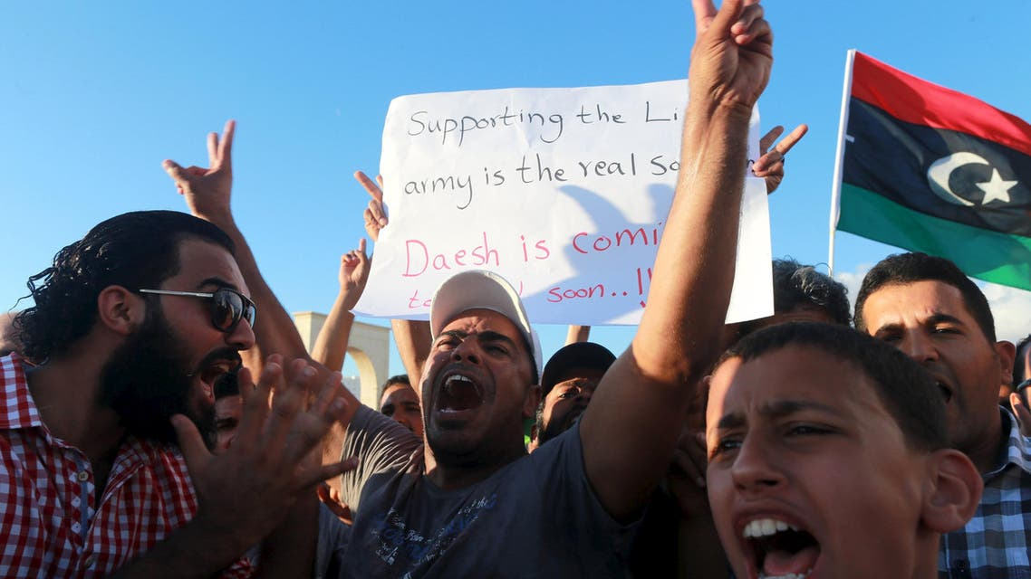 People take part in a demonstration to show support for the Libyan army under the leadership of General Khalifa Haftar, in Benghazi