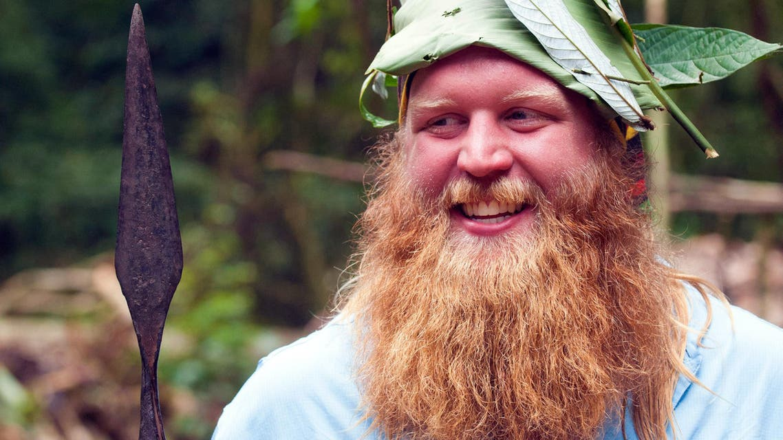 A 2014 photo provided by Justin Wren shows mixed martial arts fighter Justin Wren in the homeland of the Mbuti pygmy tribe in the Ituri Rainforest in the Democratic Republic of Congo. AP