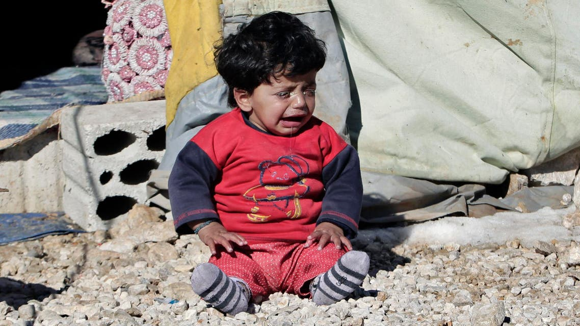 A Syrian refugee child cries outside his family tent at a refugee camp in the eastern Lebanese border town of Arsal, Lebanon, Sunday, Dec. 15, 2013. (AP)