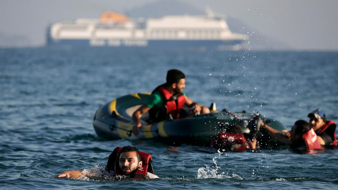 Syrian refugee swims towards a beach as others are seen on a dinghy whose engine broke down a few hundred metres from the shore of the Greek island of Kos after crossing over from Turkey. Reuters