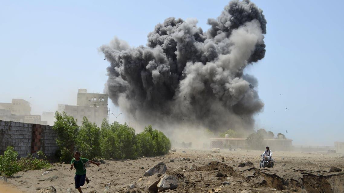 Man runs for shelter during Saudi-led air strike in Yemen's Red Sea port city of Houdieda Reuters