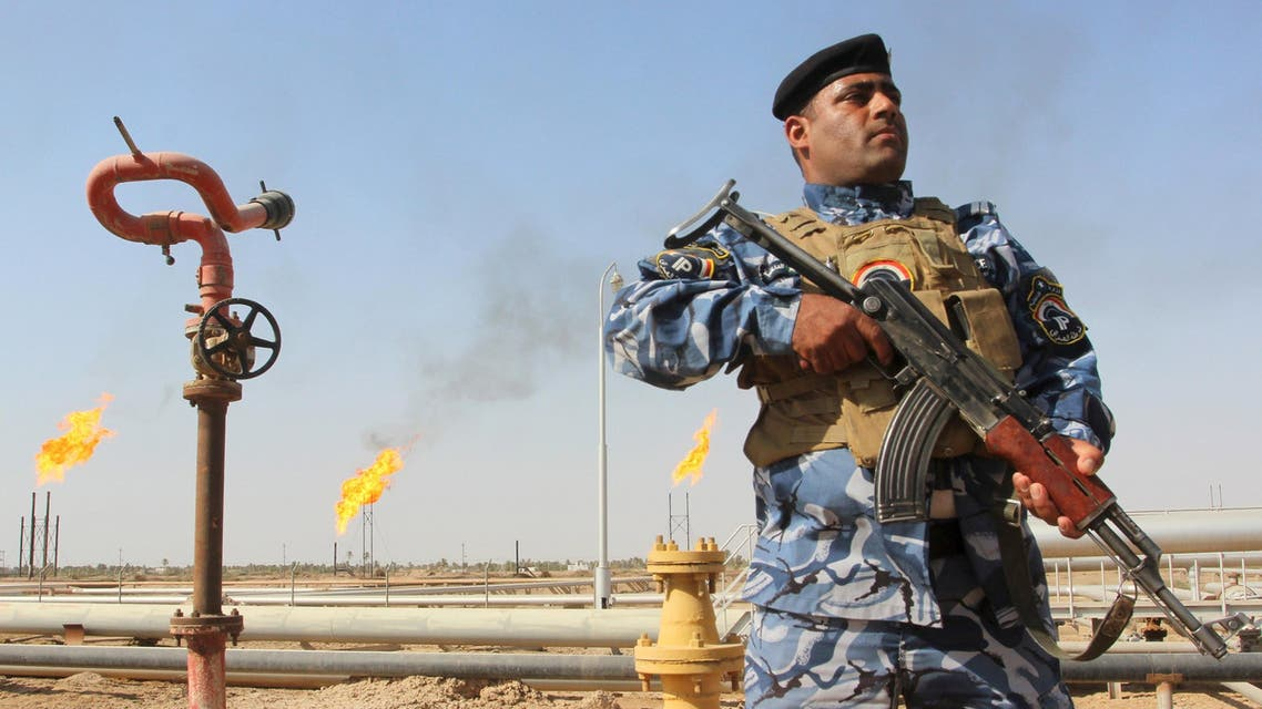 A member of the oil police force stands guard at Nahr Bin Umar oil field, north of Basra, southeast of Baghdad August 19, 2015. Iraq's oil exports have fallen by at least 250,000 barrels per day (bpd) so far in August according to loading data, making it less likely the several-month trend of rising OPEC output that has weakened oil prices will be sustained this month. REUTERS/Essam Al-Sudani