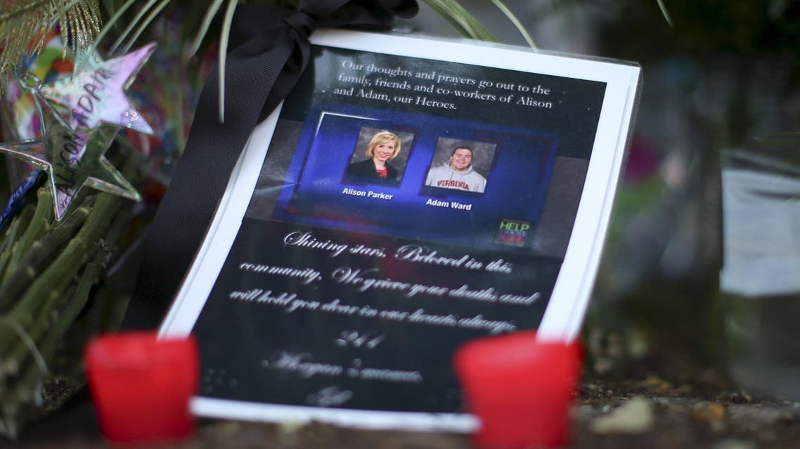 A picture of slain journalists Alison Parker and Adam Ward is seen next to candles at a memorial outside of the offices for WDBJ7 in Roanoke, Virginia August 27, 2015. (File photo: Reuters)