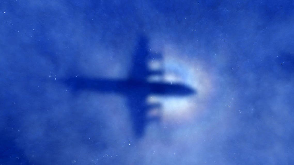 """The shadow of a Royal New Zealand Air Force (RNZAF) P3 Orion maritime search aircraft can be seen on low-level clouds as it flies over the southern Indian Ocean looking for missing Malaysian Airlines flight MH370 in this March 31, 2014 file photo. Malaysia is """"almost certain"""" that plane debris found on Reunion Island in the Indian Ocean is from a Boeing 777, the deputy transport minister said on July 30, 2015, heightening the possibility it could be wreckage from missing Flight MH370. REUTERS/Rob Griffith/Pool/Files"""