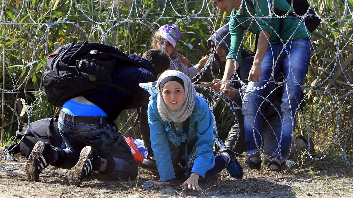 A Syrian migrant family enters Hungary at the border with Serbia near Roszke, Hungary August 28, 2015. (Reuters)