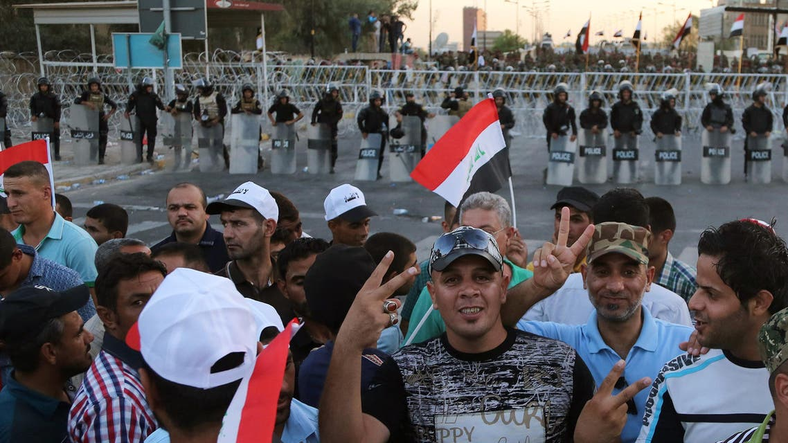 Iraqi security forces close a bridge leading to the heavily guarded Green Zone during a demonstration in support of Iraqi Prime Minister Haider al-Abadi in Tahrir Square in Baghdad, Iraq, Friday, Aug. 21, 2015. (AP)
