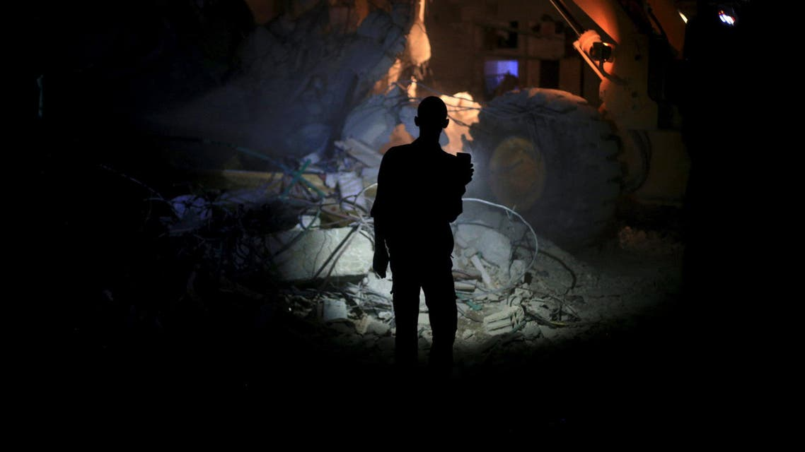 A resident inspects damage from what activists said was barrel bombs dropped by forces loyal to Syria's President Bashar Al-Assad in Douma, near Damascus. (File: Reuters)