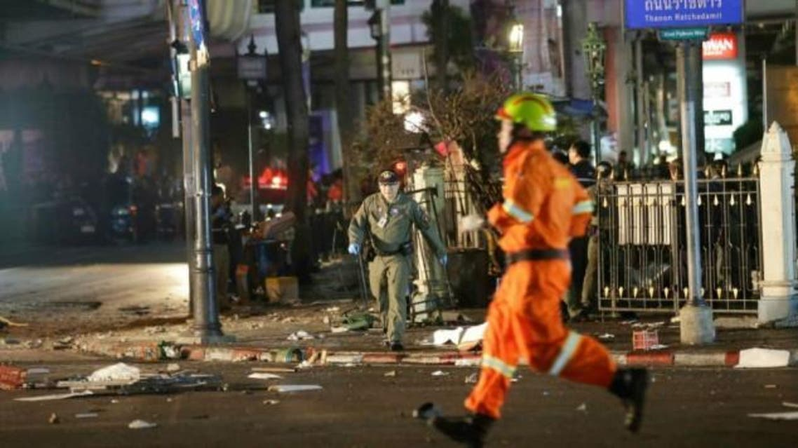 Emergency personnel work at the scene after an explosion in central Bangkok, Monday, Aug. 17, 2015. (AP)