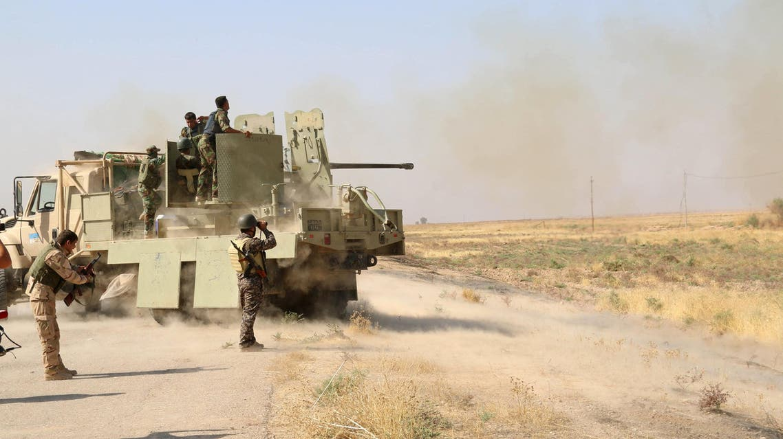 Kurdish Peshmerga fighters fire towards Islamic State militants south of Daquq, north of Baghdad August 26, 2015. (reuters)