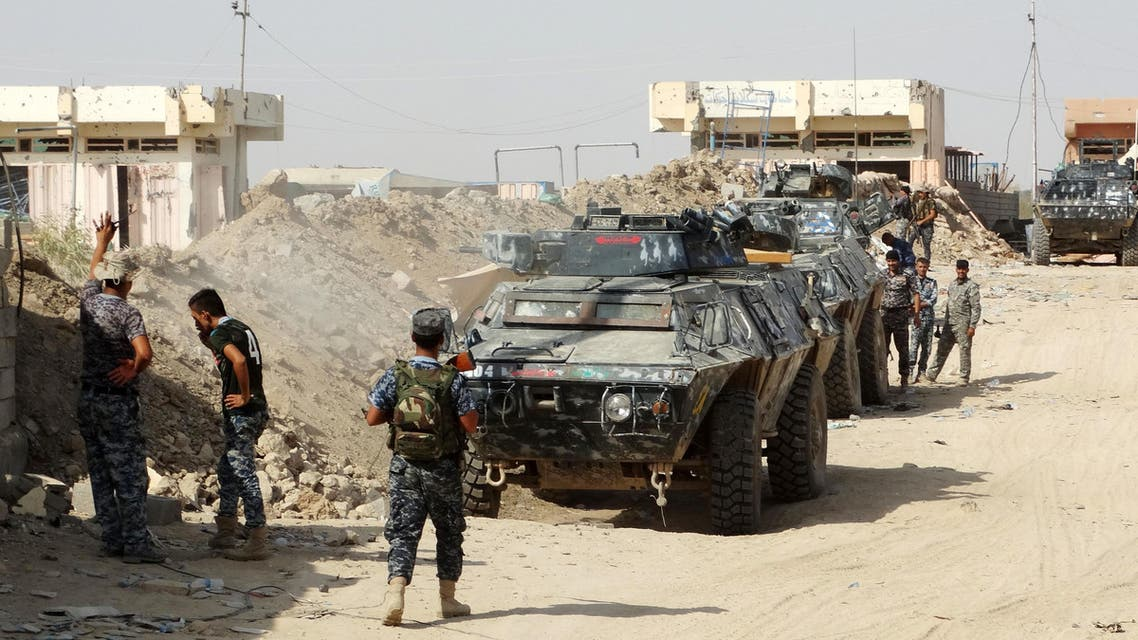In this Thursday, Aug. 27, 2015 photo, Iraqi security forces, backed by Sunni and Shiite volunteers clash with Islamic State group militants at the front line in the eastern suburbs of Ramadi, Anbar province, Iraq. (AP)