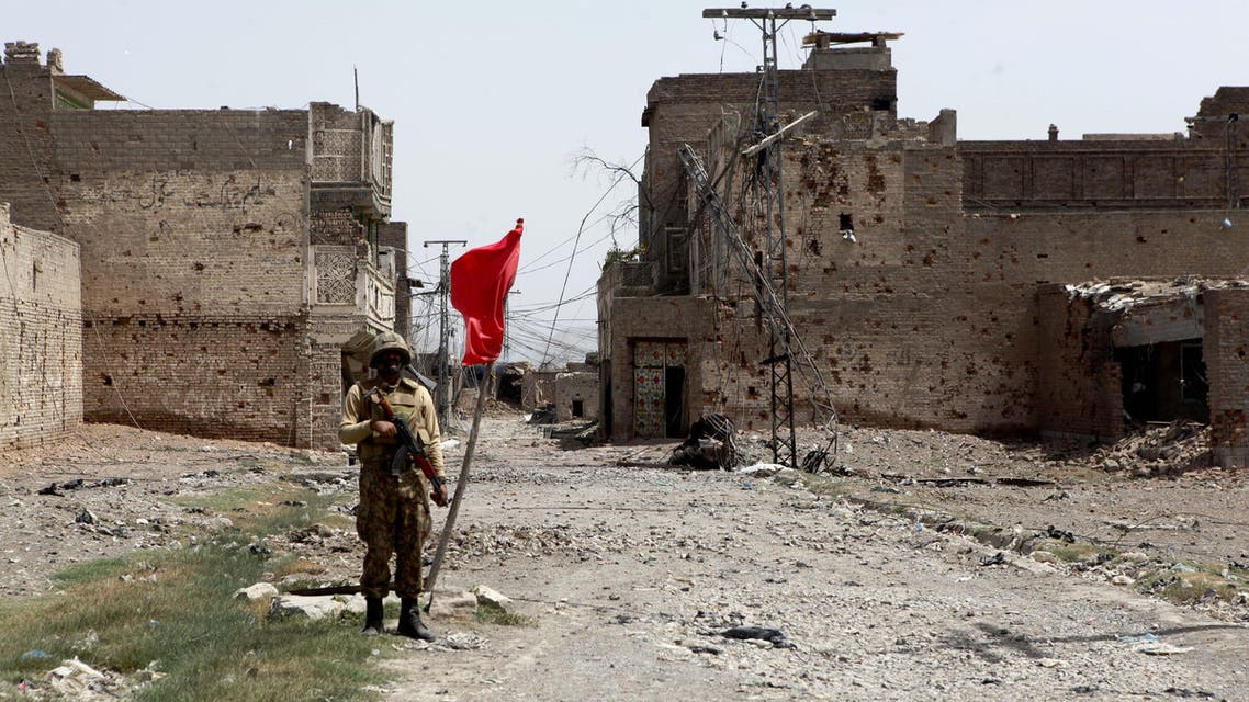 In this photo taken on Wednesday, July 9, 2014, a Pakistan army soldier stands guard at a market after driving out militants in North Waziristan (AP)
