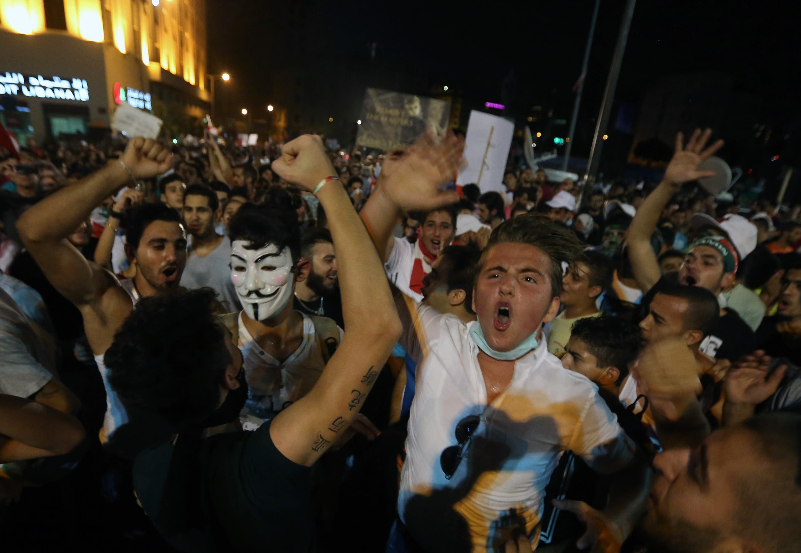 Lebanese anti-government protesters chant slogans during a protest against the trash crisis and government corruption in downtown Beirut, Lebanon, Saturday, Aug. 29, 2015.  (AP)