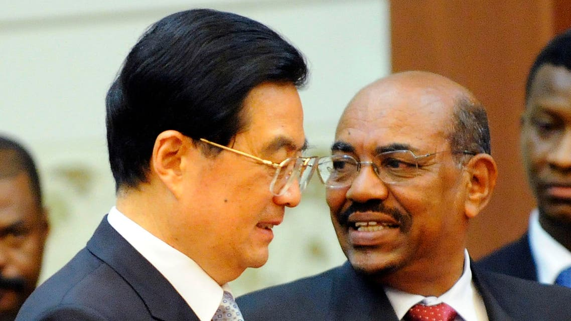 Chinese President Hu Jintao, left, and Sudan's President Omar al-Bashir arrive at the signing ceremony at the Great Hall of the People in Beijing Wednesday, June 29, 2011. China rolled out the red carpet Wednesday for a state visit by Sudan's president, who is wanted on an international warrant that accuses him of war crimes. (AP Photo/Liu Jin, Pool)