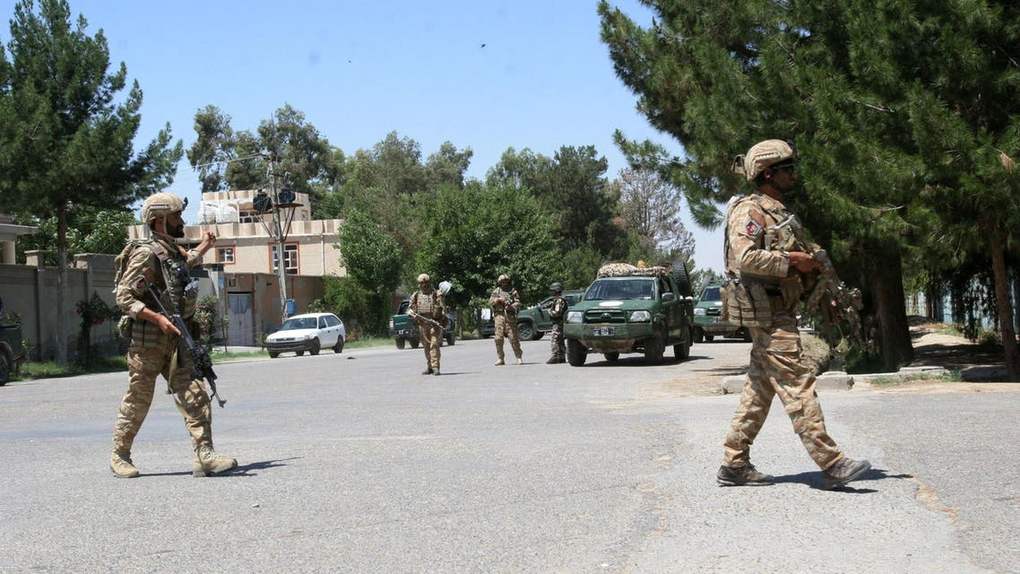 Afghanistan, security forces take position during a fighting outside a government compound in the city of Lashkar Gah, capital of Helmand province, Afghanistan, Wednesday, May. 13, 2015. Officials say gunmen have attacked a government compound in southern Afghanistan, killing three police and four civilians. (AP Photo/ Abdul Khaliq)