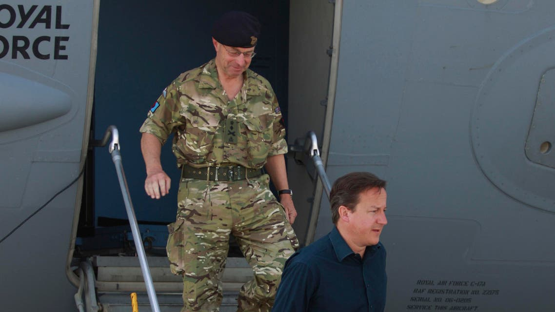 Britain's Prime Minister David Cameron, right, accompanied by General Sir David Richard, Chief of the Defence staff, ap