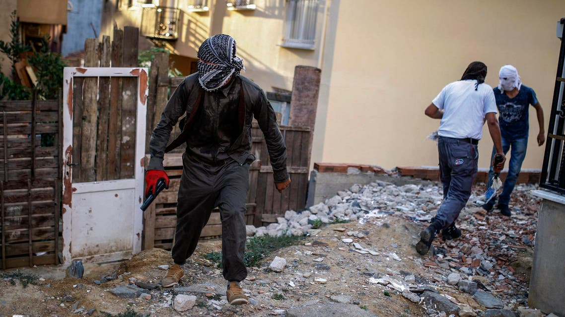 Masked leftist militants clash with security forces during a protest in Gazi district in Istanbul, Turkey, Sunday, Aug. 30, 2015. They were protesting the incidents in Turkey's southeastern area. (AP Photo/Cagdas Erdogan)