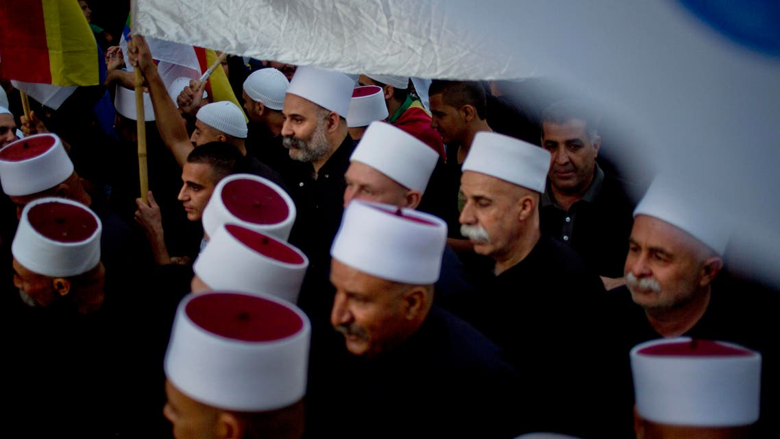 On Sunday, June 14, 2015, members of Israel's Druze minority wave their flags during a march in the Druze village of Yarka, Israel. (AP)