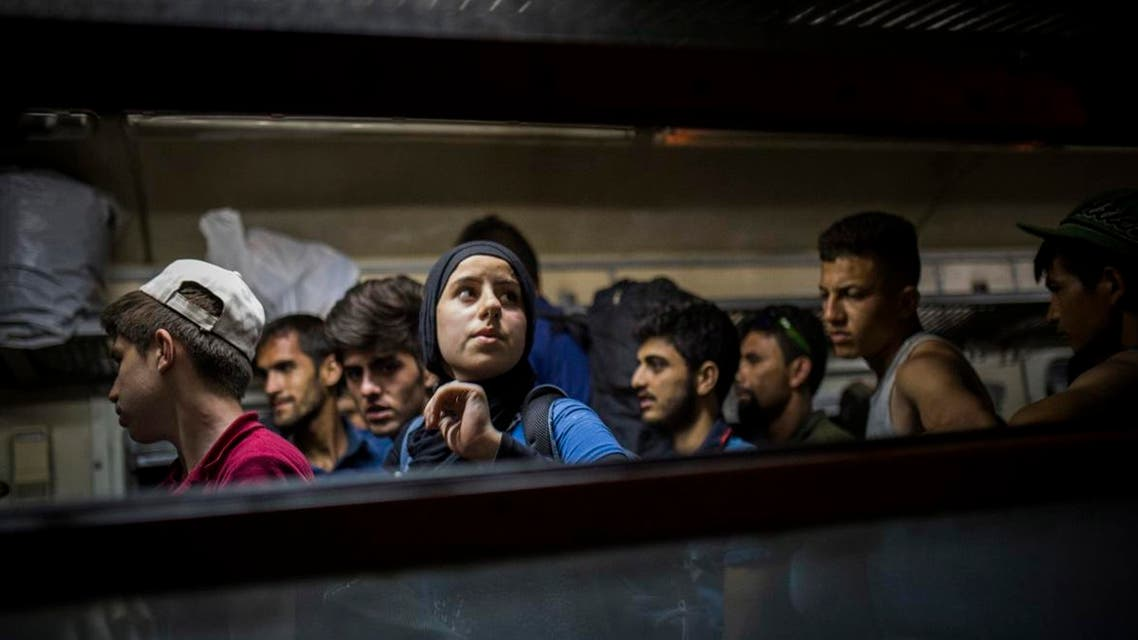 Refugees get off a train at the Macedonian station of Tabanovce, a few hundred meters away from the border with Serbia, on Friday Aug. 28, 2015. (AP)
