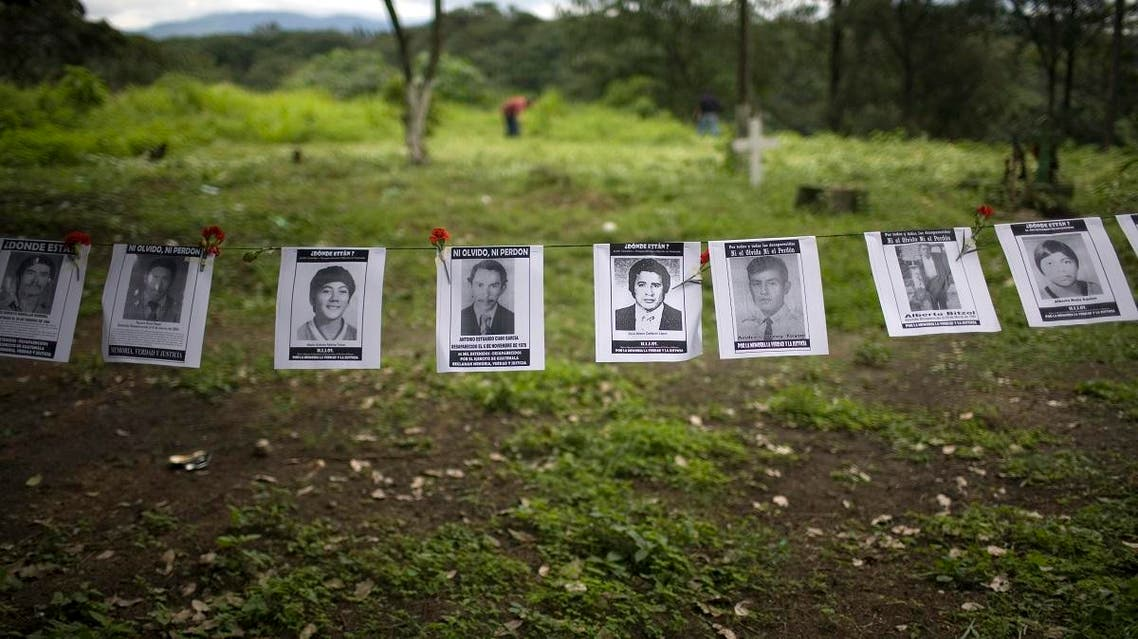 Portraits of disappeared people during the 1960-1996 internal conflict hang in La Verbena cemetery, Guatemala City, Monday, June 21, 2010. (AP)