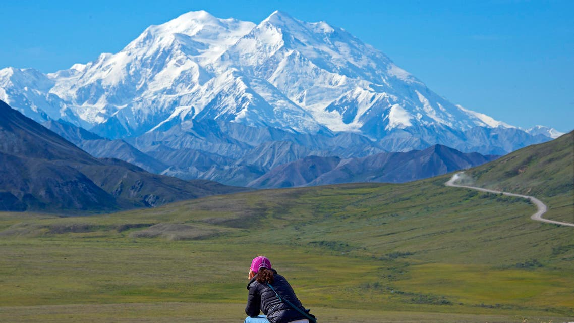 In this Monday, Aug. 3, 2015, photo provided by Holland America Line, a woman gazes at Mount McKinley in Denali National Park and Preserve in Alaska. (AP)