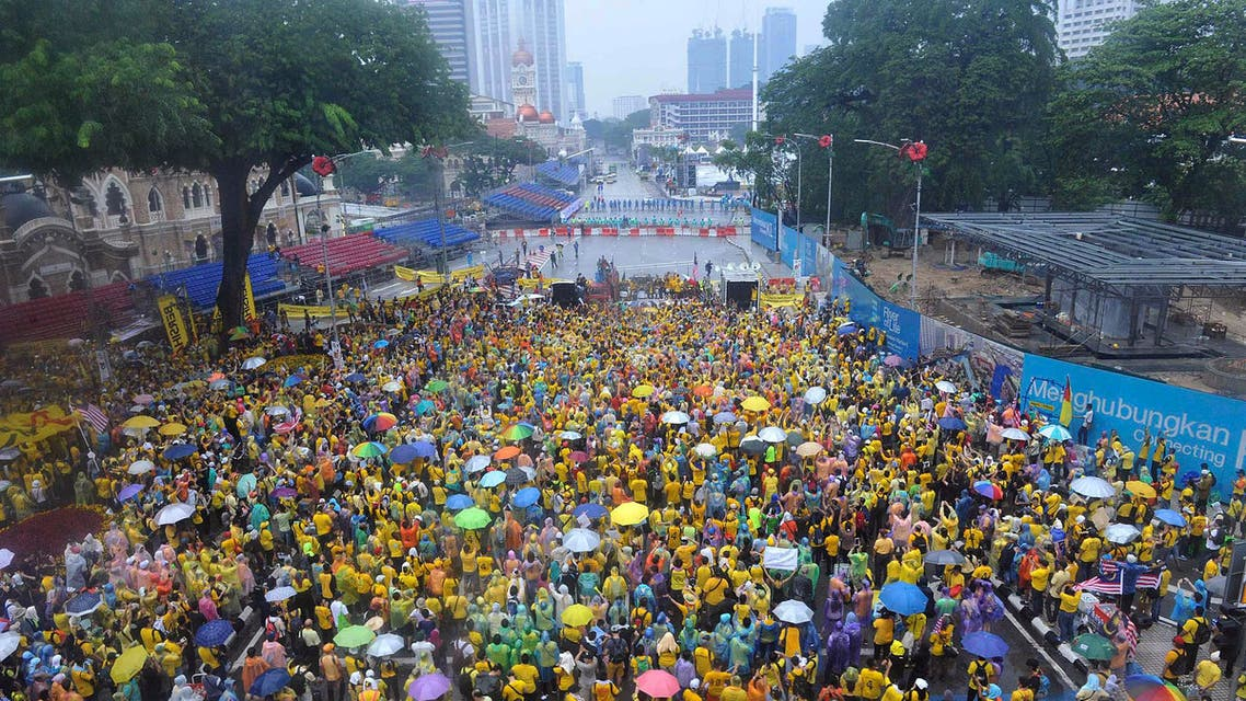 Malaysian protesters gather in the rain during a rally in Kuala Lumpur, Malaysia on Sunday, Aug. 30, 2015. Big crowds of protesters returned to the streets of Kuala Lumpur on Sunday to demand the resignation of Malaysian Prime Minister Najib Razak over a financial scandal, after the first day of the massive rally passed peacefully. (AP Photo)