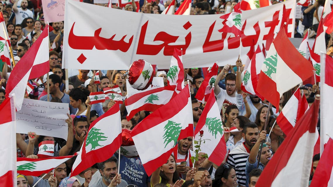 People carry Lebanese national flags and banners as they take part in an anti-government protest at Martyrs' Square in downtown Beirut, Lebanon August 29, 2015. Reuters