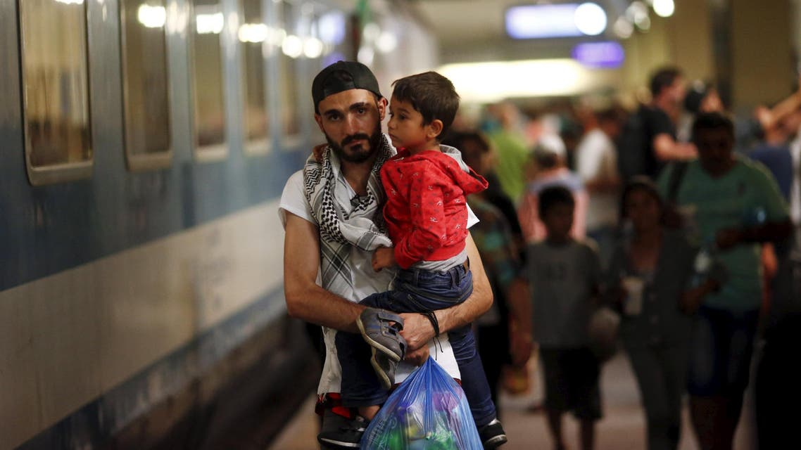 Travellers believed to be migrants leave a train coming from Hungary at the railway station in Vienna, Austria, September 1, 2015.. (Reuters)