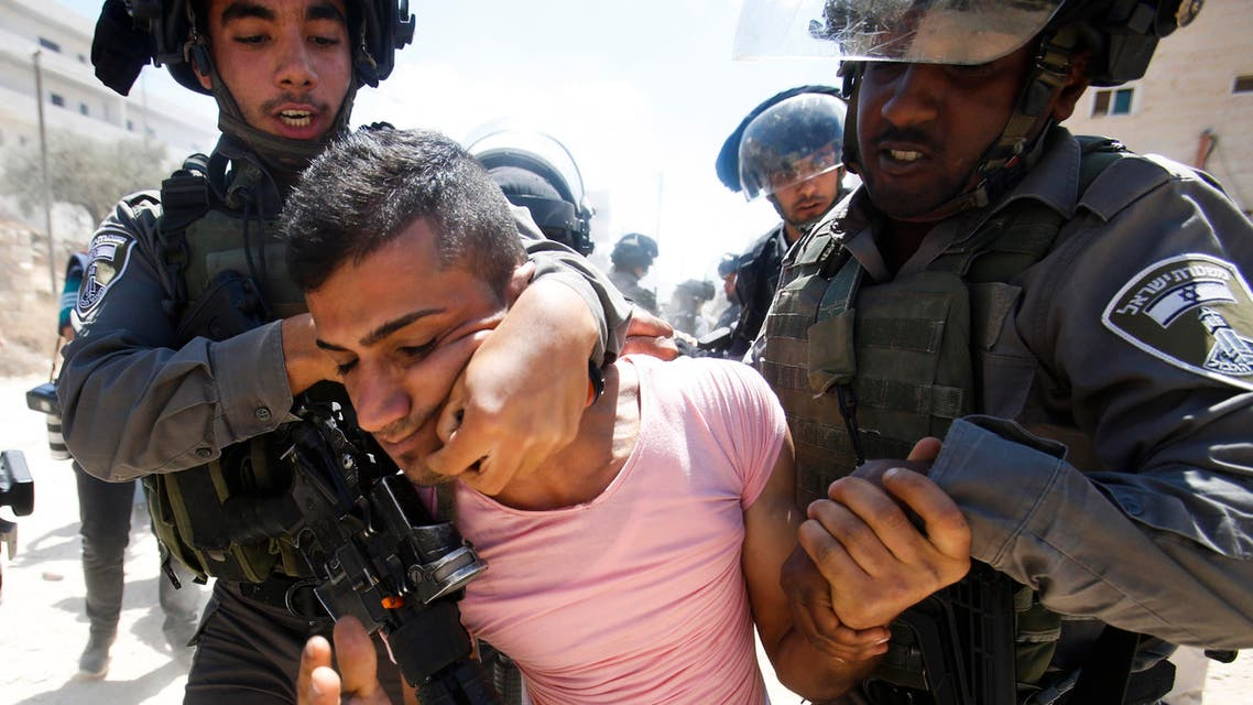 Israeli border police detain a Palestinian during a protest against the Israeli separation barrier, in Beit Jala, West Bank, Sunday, Aug. 30. (File photo: AP)
