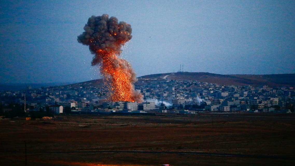 Smoke rises over Syrian town of Kobani after an airstrike, as seen from the Mursitpinar border crossing on the Turkish-Syrian border in the southeastern town of Suruc in Sanliurfa province, October 18, 2014. (Reuters)