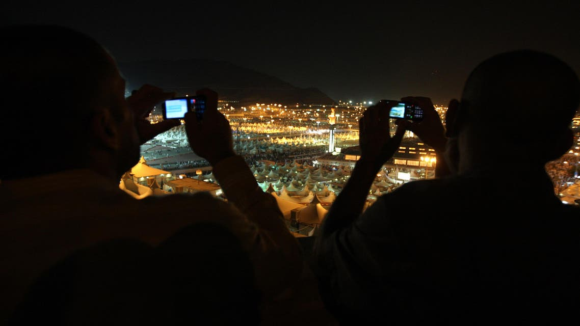 Muslim pilgrims takes pictures by their mobile to thousands of tents housing Muslim pilgrims are crowded together in Mina near Mecca. (File photo: AP)