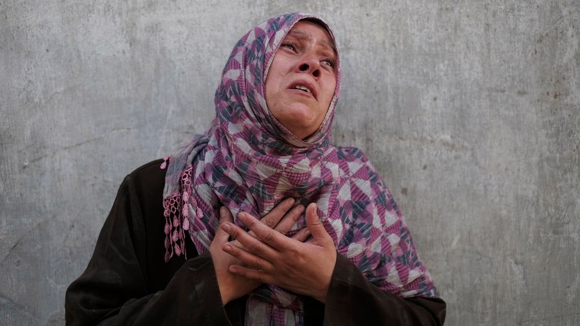 Palestinian Manal Keferna, 30, cries upon her return during a 12-hour cease-fire to the family house destroyed by Israeli strikes in Beit Hanoun, northern Gaza Strip, Saturday, July 26, 2014. (AP)